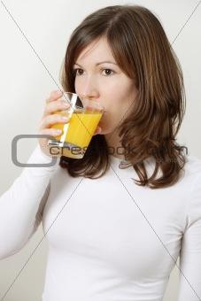 Beautiful female drinking orange juice