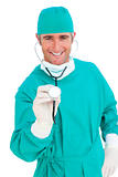 Charismatic surgeon holding a stethoscope