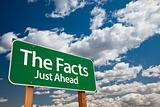 The Facts, Just Ahead Green Road Sign with Copy Room Over The Dramatic Clouds and Sky.