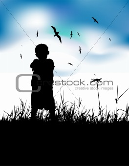 Little boy on summer field, silhouette on blue sky