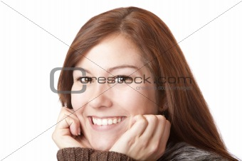 Beautiful young woman holds chin and smiles happy
