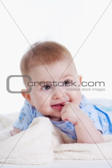 portrait of sweet little baby girl with a blanket - isolated on white
