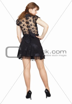 Back of young beautiful girl in a black dress