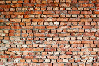 Ancient red brick wall - background