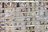 Ruined wall with wooden lattice - background