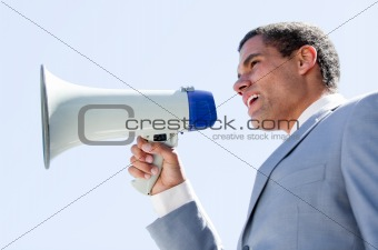 Charismatic businessman yelling through a megaphone