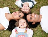 Positive family lying on the floor together