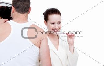 Caucasian couple brushing his teeth