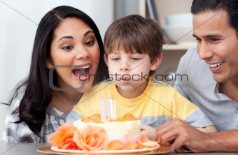 Astonished family celebrating a birthday together