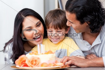 Positive family celebrating a birthday together