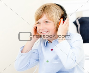 Adorable boy listenning music