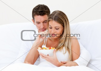 Caucasian couple having breakfast