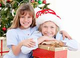Adorable childrens celebrating christmas