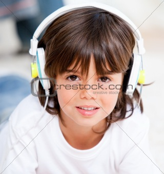 Smiling boy listenning music