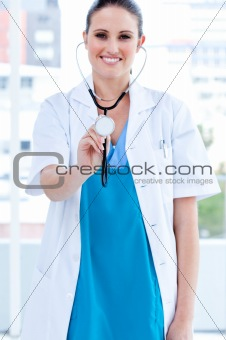 Caucasian female doctor holding a stethoscope