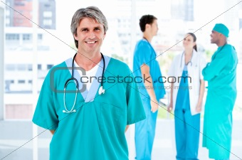 Joyful male doctor looking at the camera while his medical partn