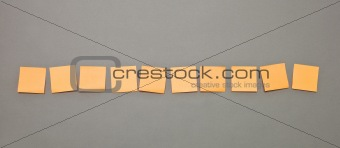 Adhesive Notes in a row