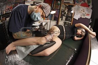 Leg tattoo on female