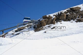 Ski lift on snowy mountainside