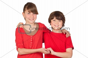 Adorable preteen girl and little gir in red