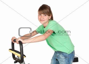 Adorable preteen girl practicing bike