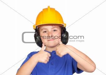 Beautiful child with yellow helmet saying OK
