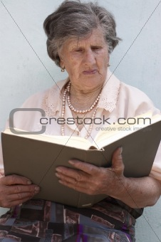 Old woman (85 years) reading book