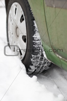 Car wheel is stuck in the snow
