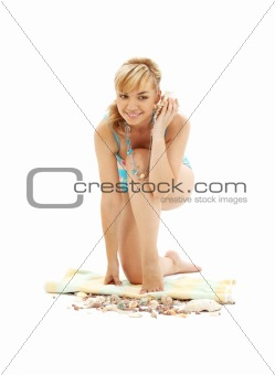 blond in blue bikini with shell