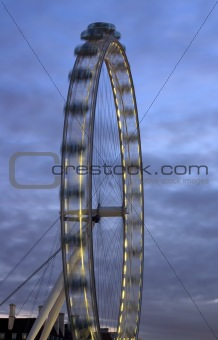 Fragment of the London Eye at night with motion and dark blue sky