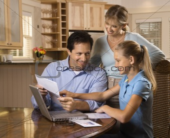 Family paying bills on computer.