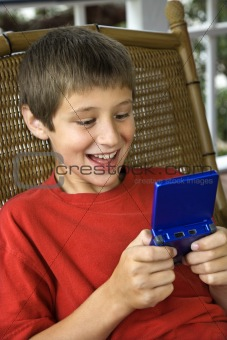 Boy playing video game.