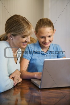 Mom and daughter looking at computer.
