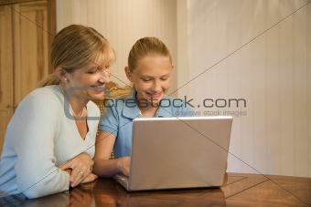 Mom and daughter using computer.