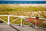 Bicycle leaning against rail on Bald Head Island, North Carolina