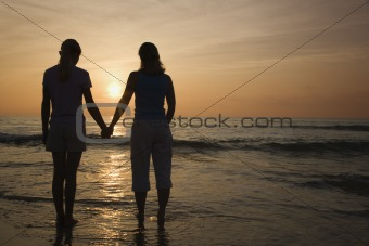 Mom and daughter at sunrise.