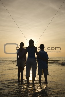 Mom and kids at beach.