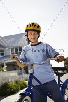 Boy on bike.