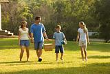 Family walking in park.