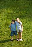 Boy and girl with arms around each other.