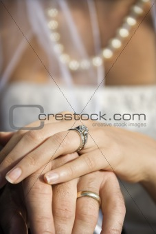 Bride's hand on top of groom's.
