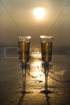Champagne glasses with sunset.