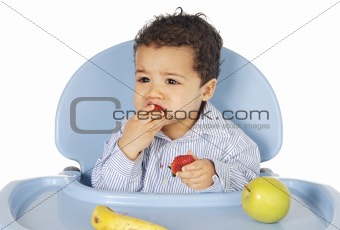 adorable baby eating fruit