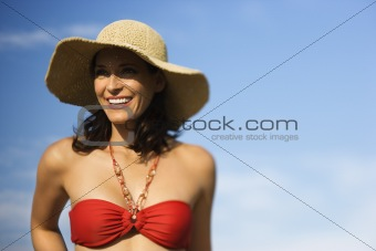 Woman in bikini and straw hat.