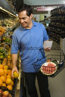 Man grocery shopping.