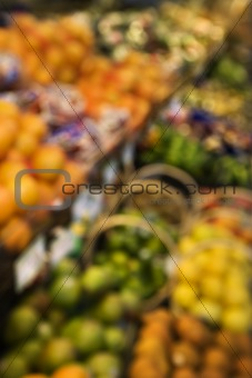 Blurred produce at grocery store.
