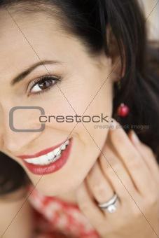 Woman wearing wedding ring.