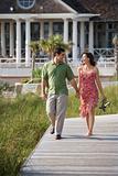 Couple walking outdoors.