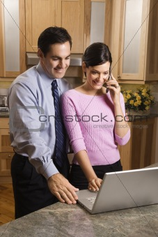 Business couple looking at laptop.