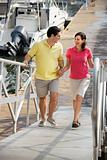 Couple walking up ramp at harbor.
